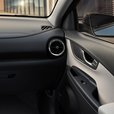 The light Beige two-tone interior of the new Hyundai Kona Hybrid compact SUV.